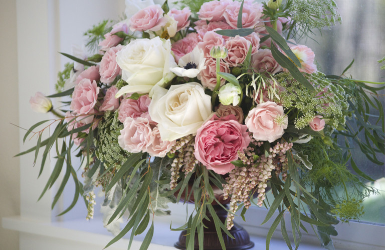 Bella Fiori Wedding Florist, Seattle Washington, bronze urn with pink and white garden roses and pieris japonica