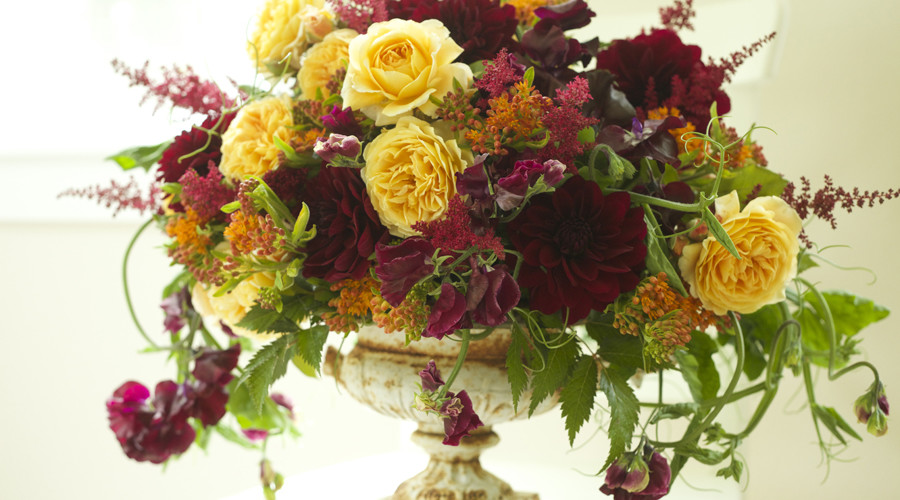 Bella Fiori Seattle Washington Wedding Florist - rustic and garden style flower arrangement with burgundy dahlias, astilbe, sweet peas, and golden garden roses