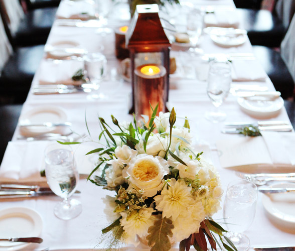 Bella Fiori, Seattle Washington Wedding Florist, Reception table set with copper lanterns, wood candle pillars and white floral centerpieces with dahlias, garden roses, dusty miller